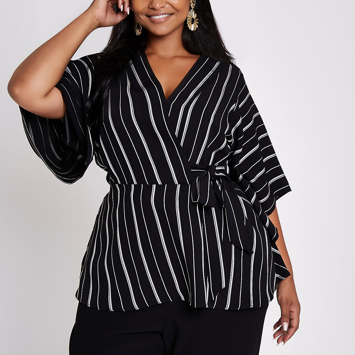 Plus black stripe tie side wrap top