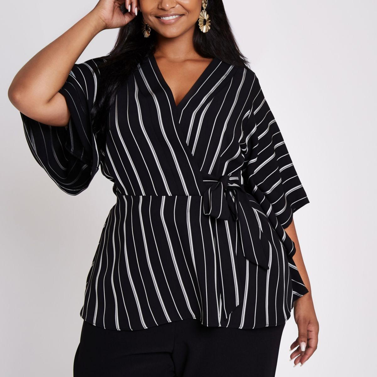 Plus black stripe tie side wrap top