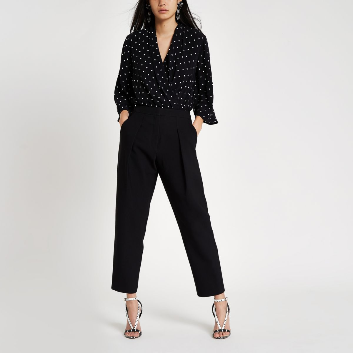Black fitted peg trousers
