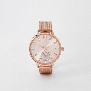 Roségoudkleurig rond horloge met diamantjes en bandje van mesh