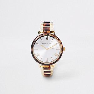 Bruin rond horloge met goudkleurig schakelbandje