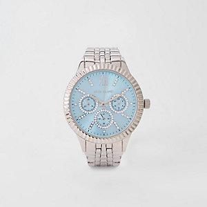 Zilverkleurig horloge met blauwe ronde wijzerplaat en schakelbandje