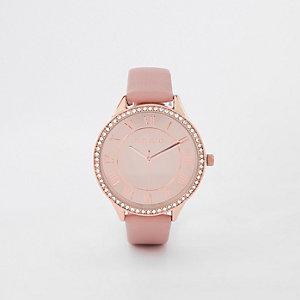 Roze horloge met roségoudkleurige ronde wijzerplaat met diamantjes