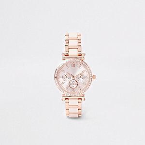 Roze horloge met roségoudkleurig schakelbandje en diamantjes