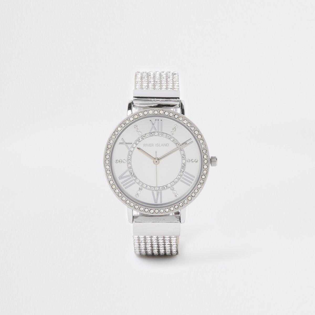 Silver tone rhinestone encrusted strap watch