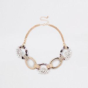 Goudkleurige ketting met ovaalvormige in elkaar gelinkte schakels met diamantjes