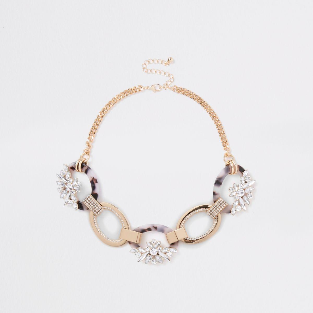 Gold tone oval interlinked rhinestone necklace