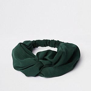 Groene brede gedraaide haarband