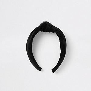 Zwarte corduroy hoofdband met knoop