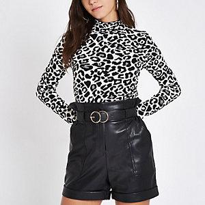 Beige leopard print turtleneck top
