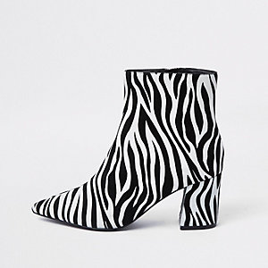 Black zebra print pointed block heel boots