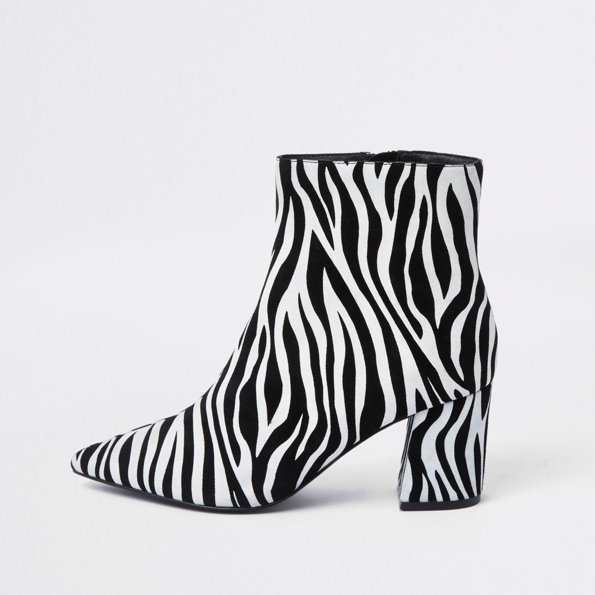 Black zebra print pointed block heel boots
