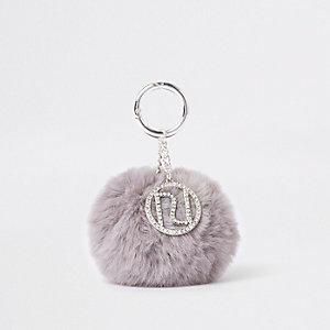 Porte-clés à pompon en fausse fourrure gris