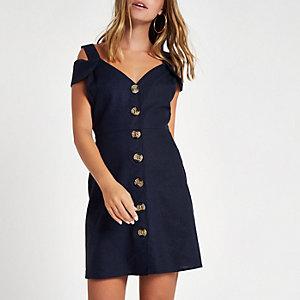 RI Petite - Marineblauwe mini-jurk met bardothalslijn en knopen voor