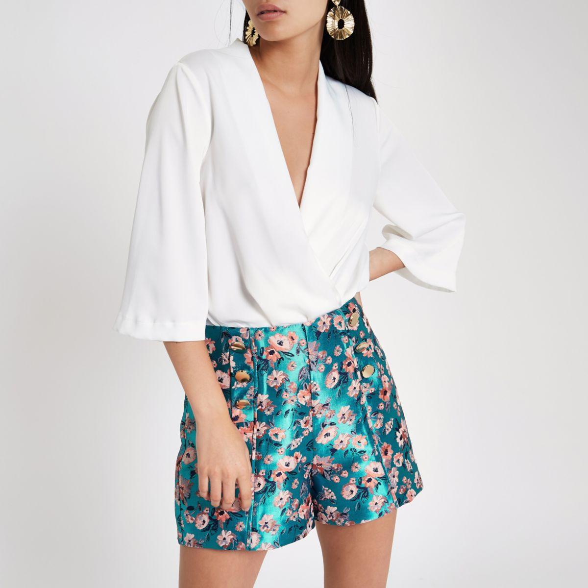 Blue floral jacquard button front shorts