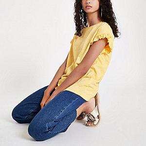 Geel T-shirt met ruches op de mouwen