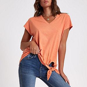 Oranje T-shirt met -hals en knoop voor
