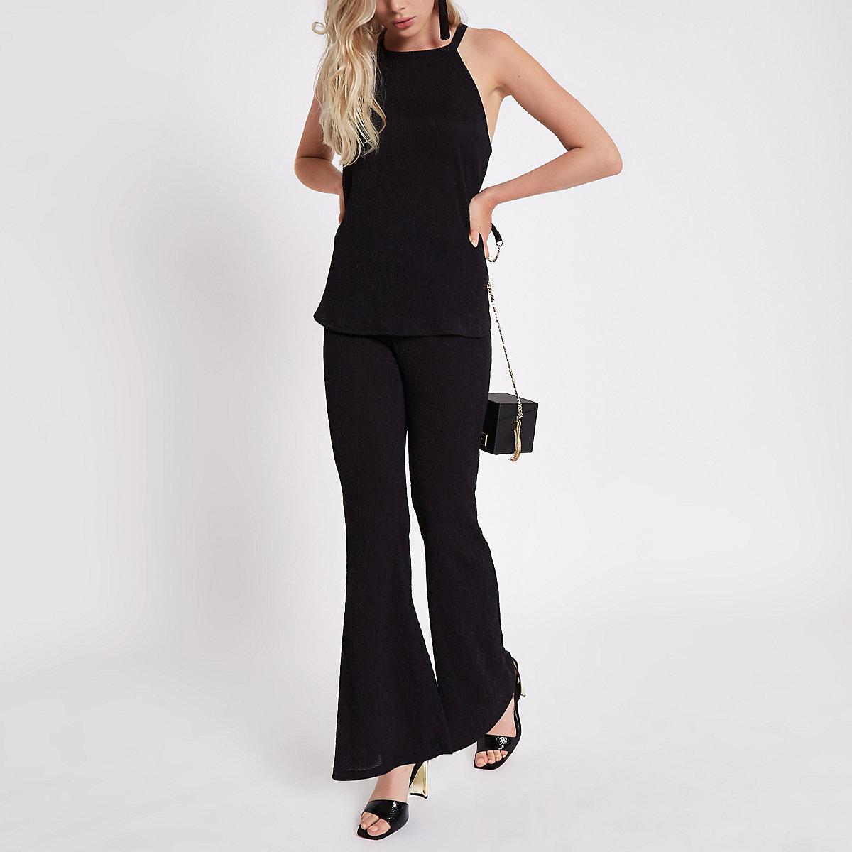 Schwarze, strukturierte Hose