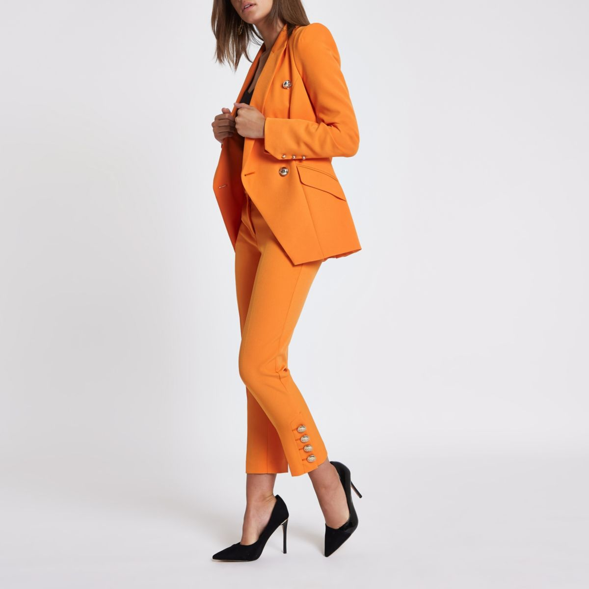 Orange gold tone button cigarette pants