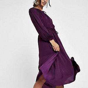 Paarse gesmokte midi-jurk met strik bij de hals
