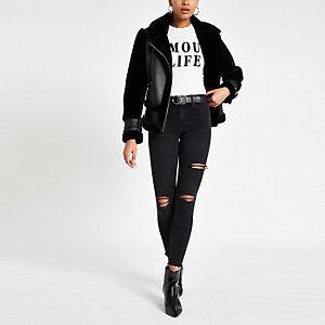 Molly - Zwarte wash ripped jegging met halfhoge taille