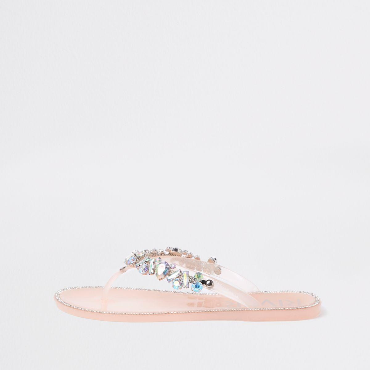 Pink jewel embellished flip flops
