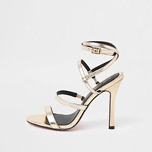 Goudkleurige sandalen met smalle hak en bandjes