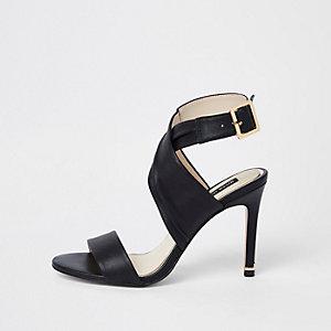 Sandales enveloppantes en cuir noires à talon aiguille