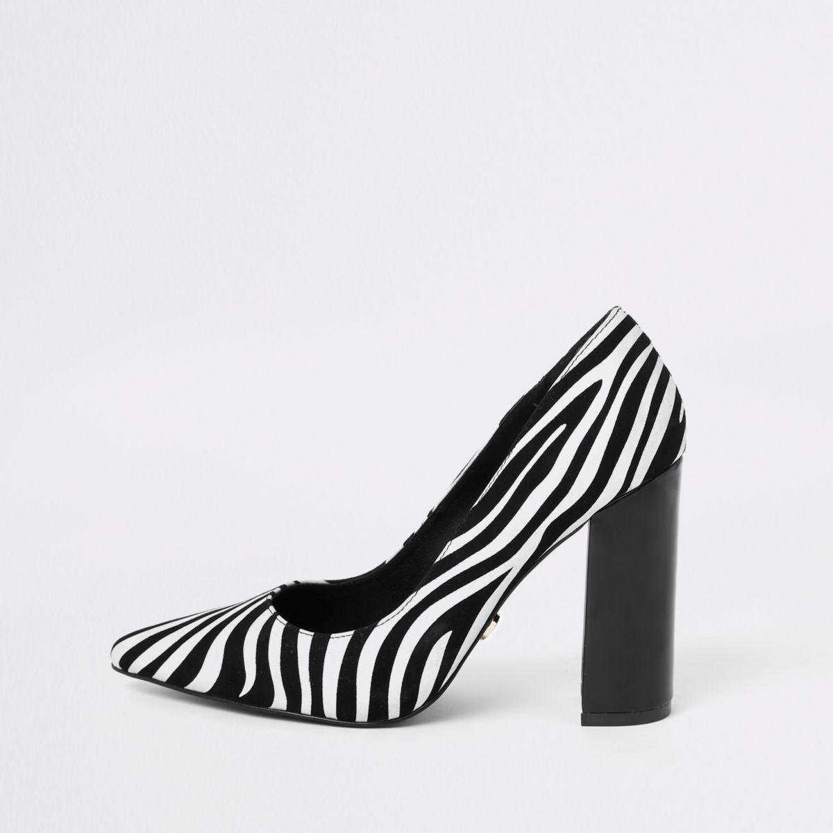 Black zebra print block heel pumps