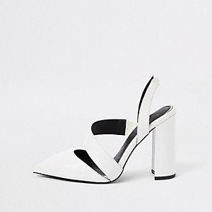 White croc asymmetric block heel pumps