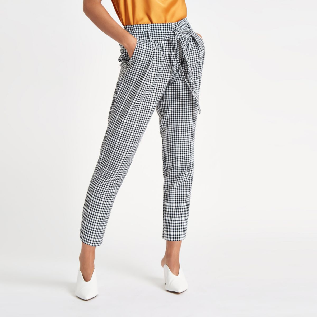 Petite black check tapered trousers