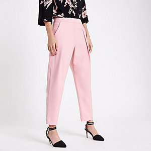 Pink pleated peg trousers