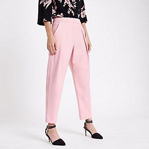 Pantalon carotte rose plissé