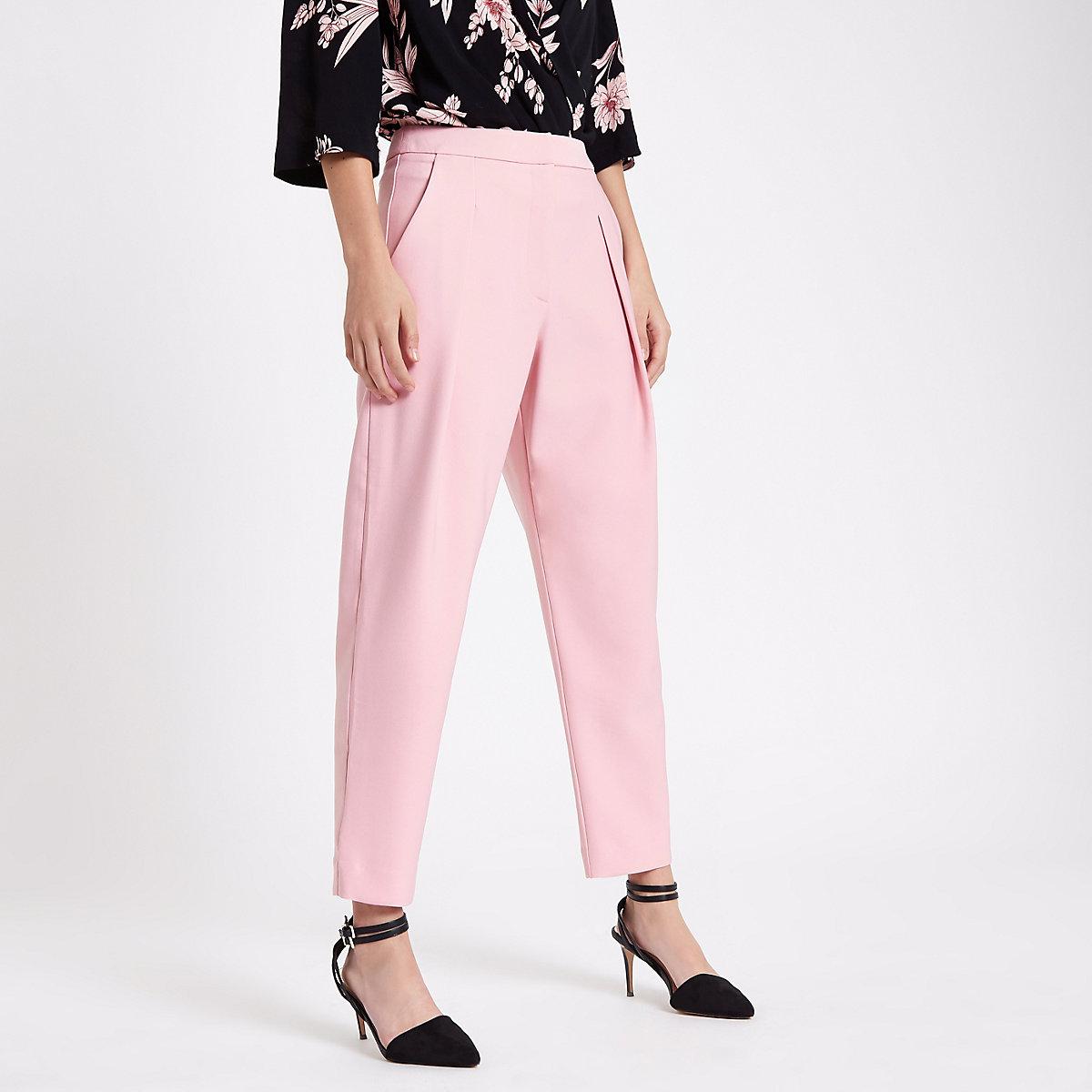 Pink pleated peg pants