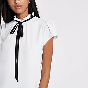 Cream high tie neck short sleeve top