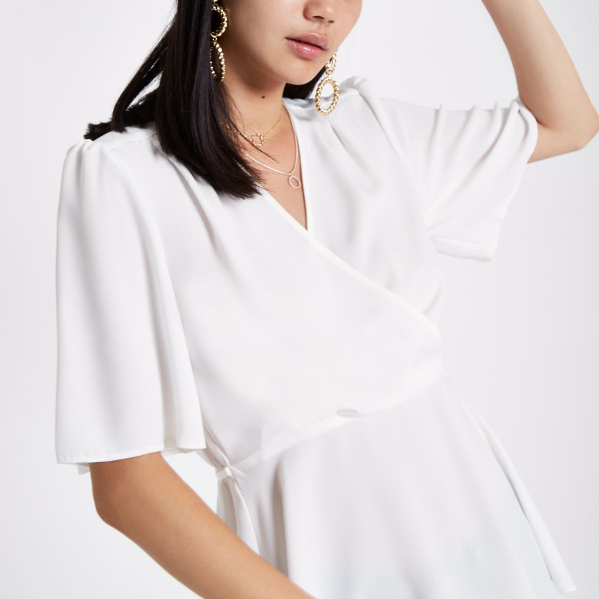 White short sleeve fitted wrap blouse