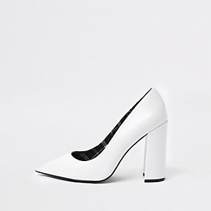 White croc embossed block heel court shoes