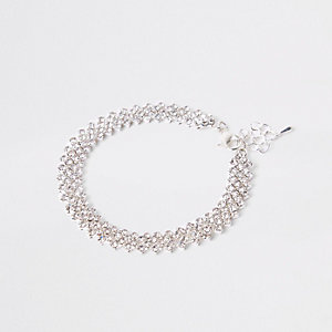 Bracelet argenté orné de strass à plusieurs rangs
