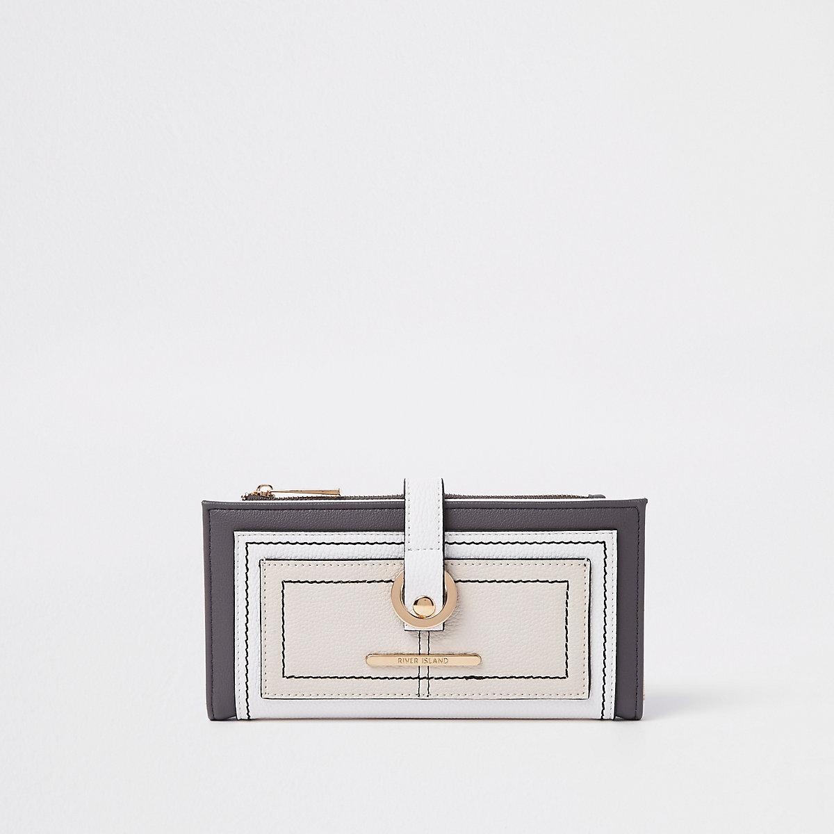 Light beige pocket front hoop purse