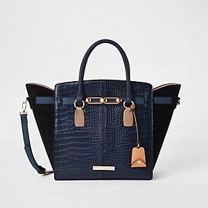 Marineblauwe handtas met zij-inzetten en krokodillenprint met reliëf