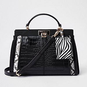 Zwarte handtas met krokodillenreliëf en panelen met dierenprint