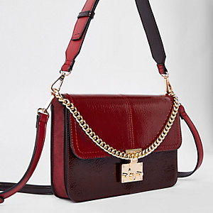 Dark red lock front underarm bag