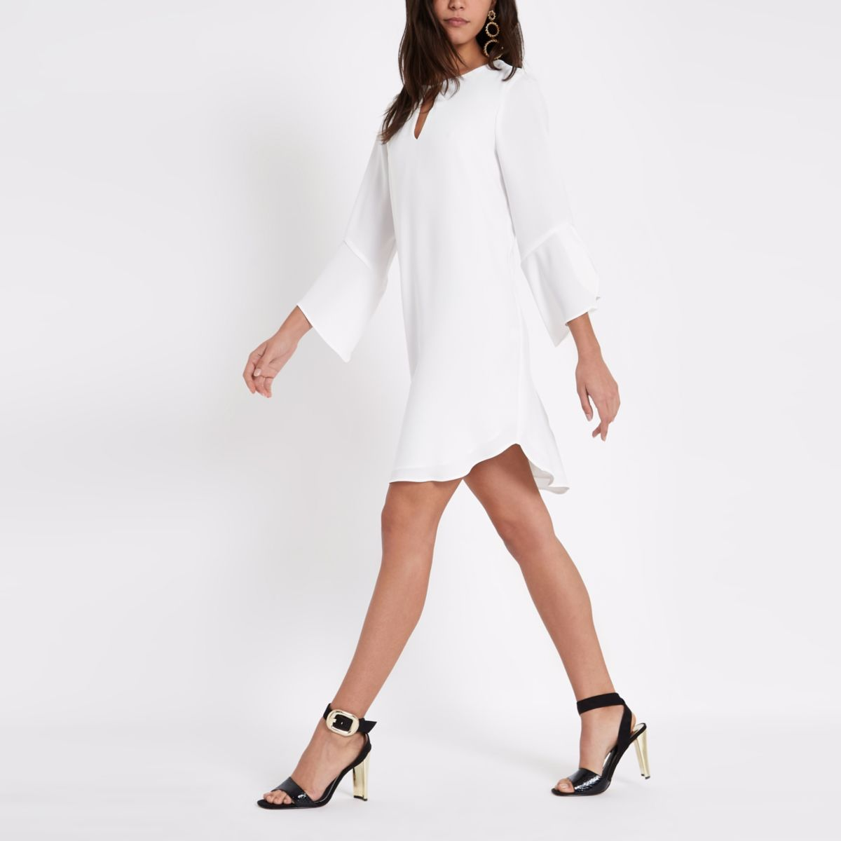 Cream frill sleeve swing dress