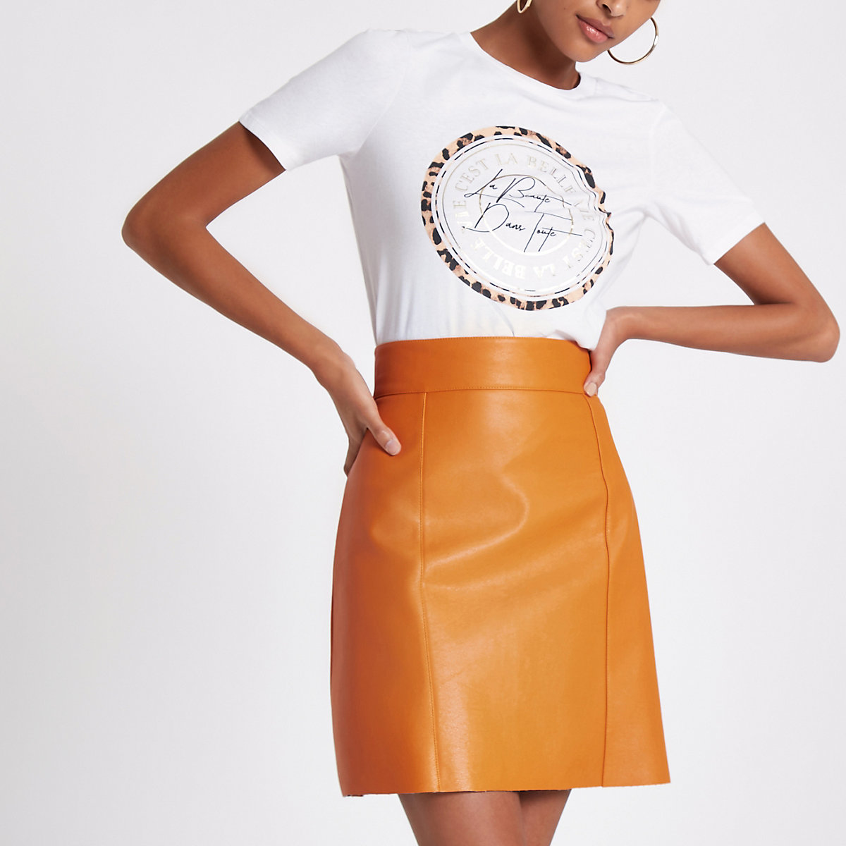 Orange faux leather mini skirt