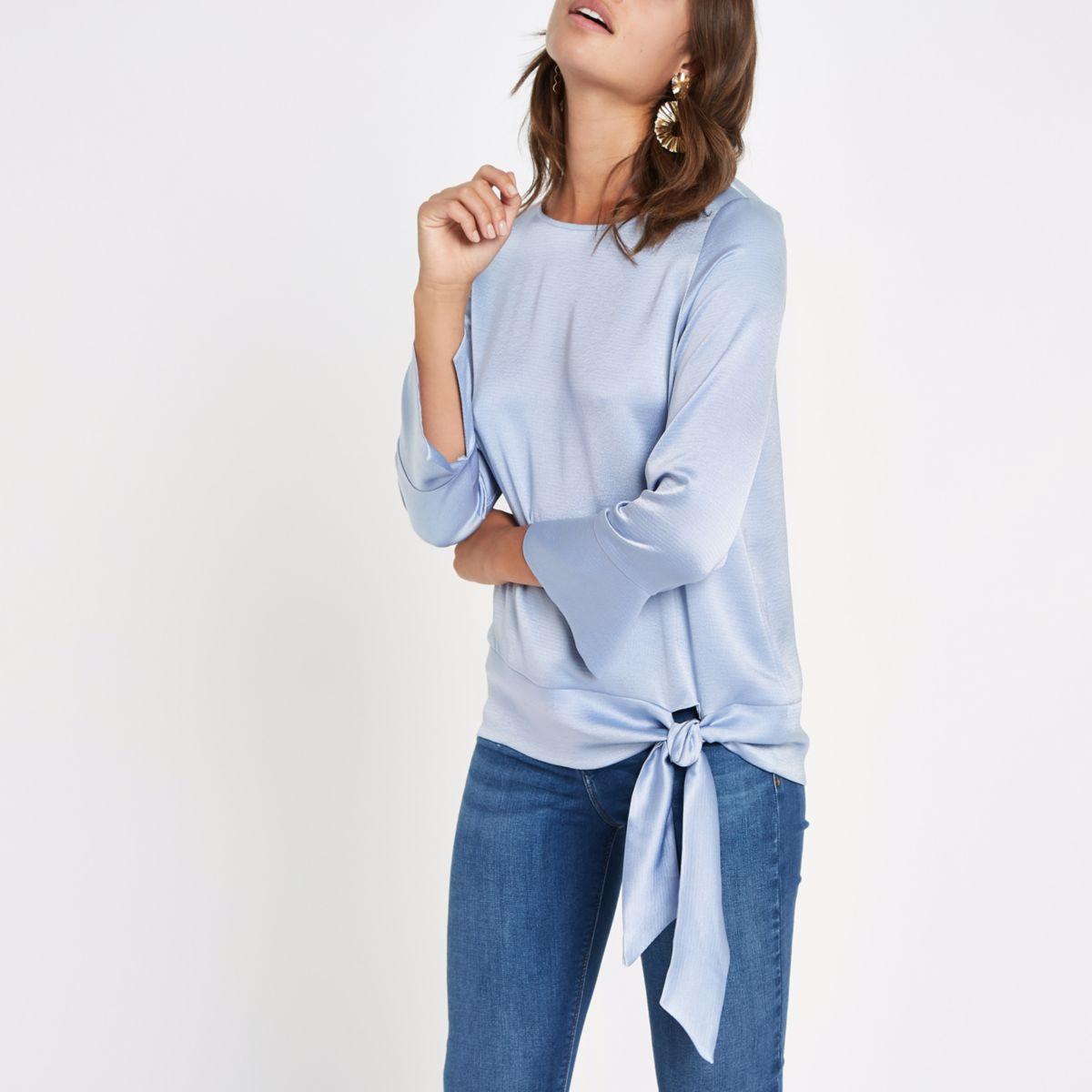 Blauwe top met lange mouwen en zijbandje