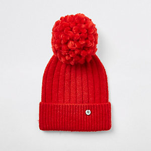 Red pom pom bobble top knit beanie hat
