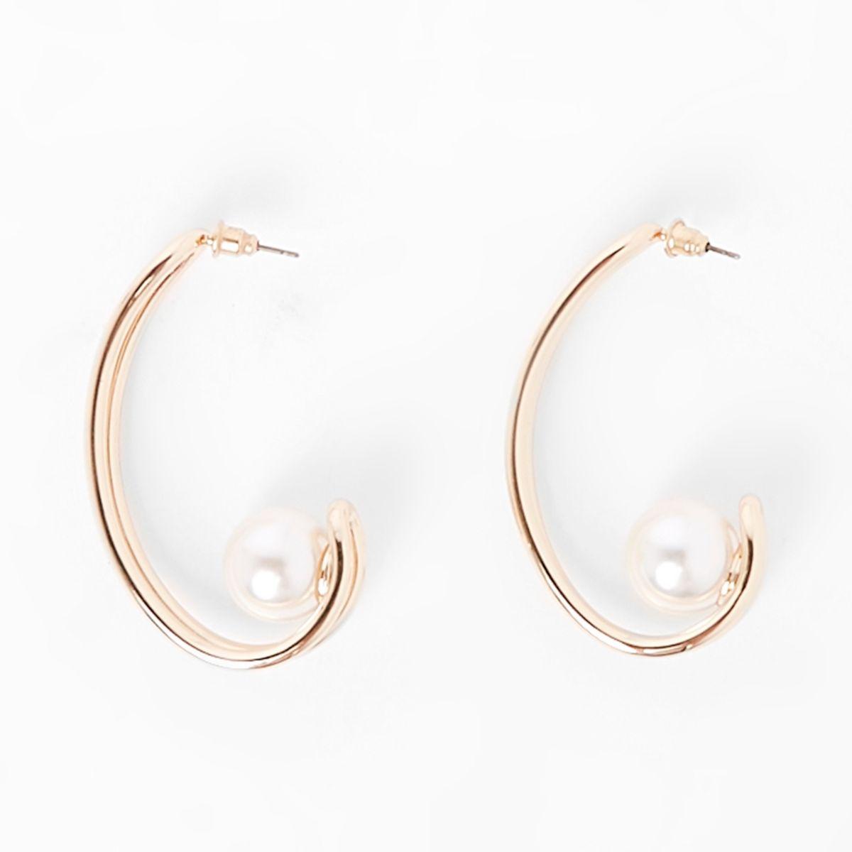 Gold tone pearl curve earrings