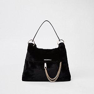 Zwarte ruime tas met imitatiebont en ketting voorop