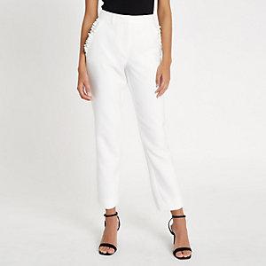 Pantalon cigarette blanc à poches à volants