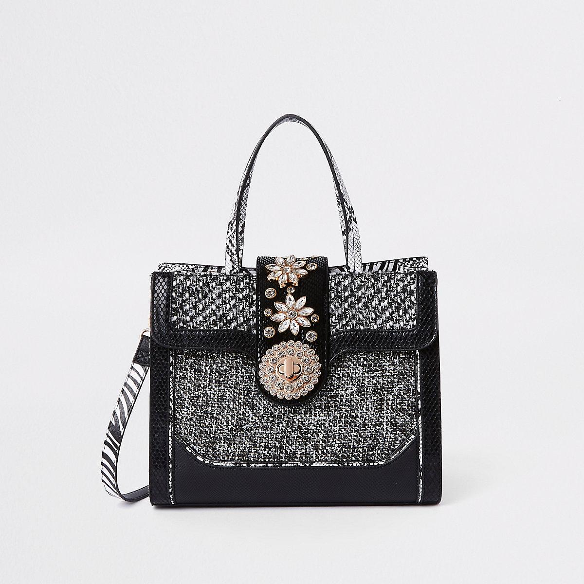 Zwarte handtas van gecombineerde stof met slot voorop